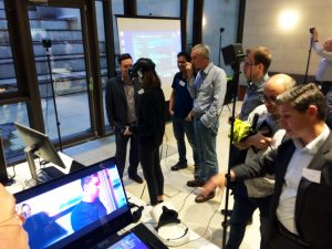 Group of researchers and students try the VR technology.