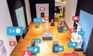 Exhibition room in the Ashmolean Museum of Art and Archaeology with social media symbols next to objects, showing likes and comments across different platforms