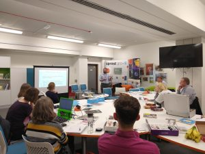 Participants in the first Digital Maker workshop using technology, including Raspberry Pis and Micro:bits creatively